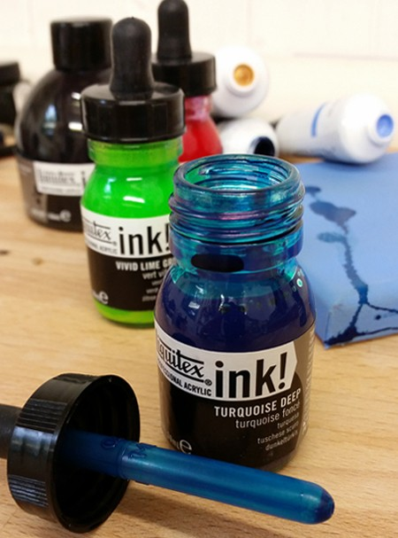 Liquitex Ink can be used with Acrylic Paint on canvas