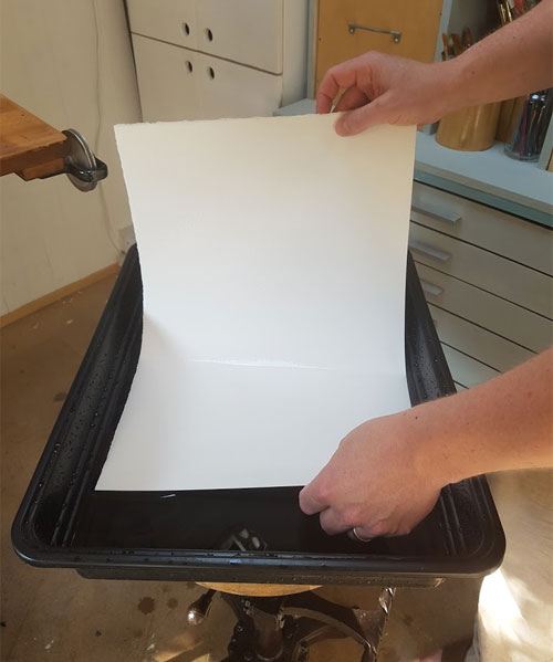 Wetting a piece of Watercolour Paper